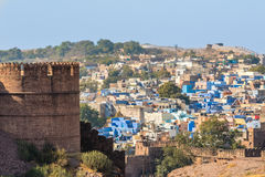 Blue City and Mehrangarh Fort. The Blue City of Jodhpur with the battlements of Mehrangarh Fort Stock Photo