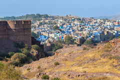 Blue City and Mehrangarh Fort. The Blue City of Jodhpur with the battlements of Mehrangarh Fort Stock Images