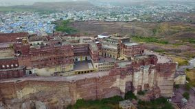 The Blue City and Mehrangarh Fort in Jodhpur. Rajasthan, India. Aerial shot.The Blue City and Mehrangarh Fort in Jodhpur. Rajasthan, India Professional shot in stock footage