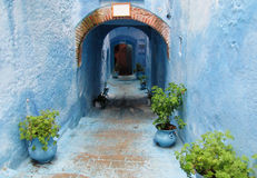 Blue city street with walls and arch. Blue city Chefchaouen street. Chefchaouen or Chaouen city in Morocco. Blue house walls on the street of an ancient city Stock Photo