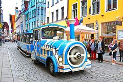 Blue City Train, tourist sightseeing vehicle, is driven through Pikk Steet in the Old Town of Tallinn, Estonia. UNESCO World Heritage site royalty free stock photo