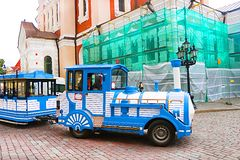 Blue City Train, tourist sightseeing vehicle, is driven through steet near Alexander Nevsky Cathedral in the Old Town of Tallinn. UNESCO World Heritage site stock photos