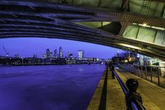 The blue city under a riveted sky stock photography