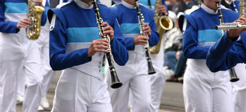 Blue clarinet & winds players. Blue clarinet & winds players in marching bandCalgary Stampede ParadeCalgaryAlberta Royalty Free Stock Photography