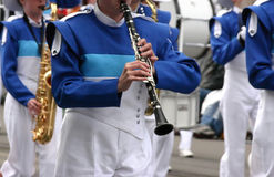 Blue clarinet & winds players Stock Photography