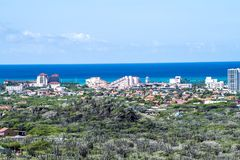Aruba, view over landscape with cacti to International Hotels royalty free stock images