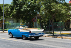 Blue classic cabriolet car drived trough Varadero in Cuba Royalty Free Stock Photo