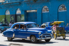 Blue classic car drives in province Villa Clara in Cuba on the street Stock Photo