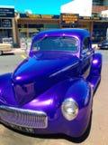 Blue classic car. An old blue car on the street Stock Photos