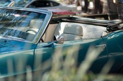 Blue Convirtable Classic Car with blurry grass royalty free stock photo
