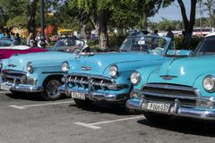 Blue classic cars in line, Havana, Cuba Royalty Free Stock Photo