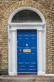 Blue classic door in Dublin, example of georgian typical architecture of Dublin Ireland. Blue classic door in Dublin, example of georgian typical architecture of royalty free stock photos