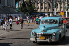 Blue classic old American car near Capitole in Havana Royalty Free Stock Image