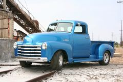 Blue classic pickup on train track