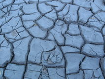 Blue Clay. Dry cracked blue clay surface background Stock Photos
