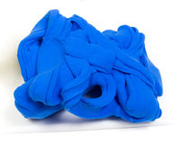 Blue clay. Glob of bright blue clay.  Against a white background Stock Photography