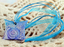 Blue clay amulet Stock Image