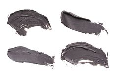 Blue clay facial mask smear on white isolated background. Set of cosmetic mud mask smears isolated on white background. Top view, closeup texture of black facial stock image