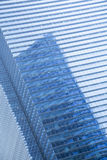 Blue,clean glass wall of modern skyscraper Royalty Free Stock Image