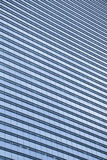 Blue,clean glass wall of modern skyscraper Royalty Free Stock Images