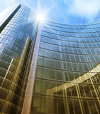 Blue clean glass wall of modern skyscraper. Modern glass skyscraper perspective view Stock Image