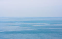Blue clean sea or ocean and clear sky background. Blue clean tropical sea or ocean and clear sky background Royalty Free Stock Photos