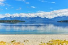Manapouri lake beach Royalty Free Stock Images