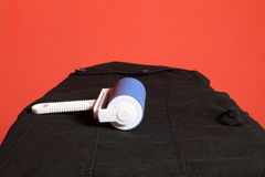 Blue cleaner dust with lint roller Royalty Free Stock Image