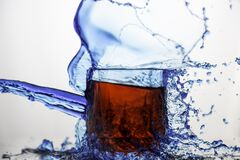 Blue Clear Glass Cup Splashed of Water Stock Photo