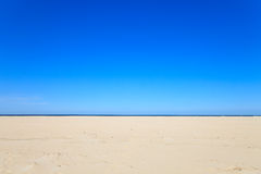 A blue clear sky with beach and ocean Royalty Free Stock Photography