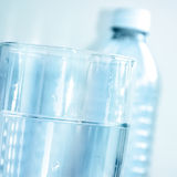 Blue Clear Water Glass and Water Bottle Stock Photos