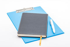 Blue clipboard,notebook and pen. Blue clipboard,notebook and pen isolated on white background Royalty Free Stock Photos