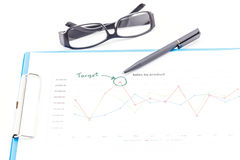Blue clipboard, pen, glasses and business graph. Royalty Free Stock Photography