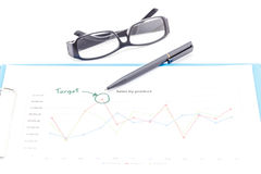 Blue clipboard, pen, glasses and business graph. Stock Photo