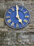 Blue clock. A gilded blue clock on a church tower Stock Photo