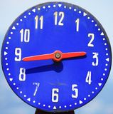 Blue clock Stock Images