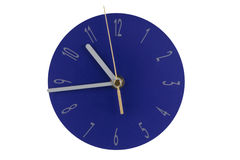 Blue clock. A modern blue clock, isolated photo Royalty Free Stock Photography