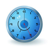 Blue clock. Blue wall clock with a metal round Royalty Free Stock Image