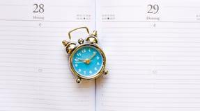 Blue clock on agenda Stock Photo