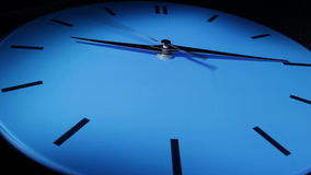 Blue clock. Time lapse.