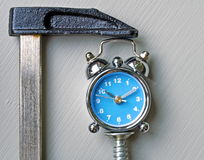 Blue clock under pressure Royalty Free Stock Photos