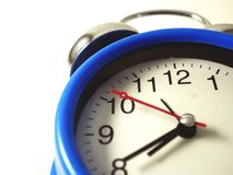 Blue clock in a white background stock image