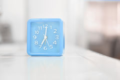 Blue clock. On white tone Stock Images