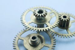 Blue clockwork gears background Stock Image