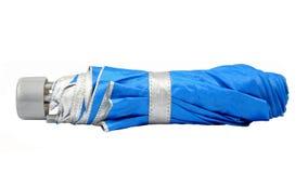 Blue closed umbrella  on white Stock Image