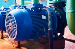 Blue electric motor with pump close-up. Abstract background. Royalty Free Stock Image