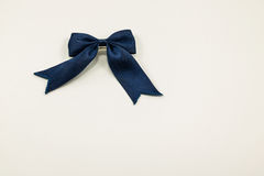 Blue cloth bow on a white background. royalty free stock photos