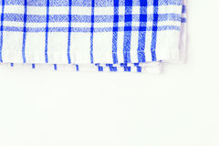 Blue cloth, a kitchen towel with a checkered pattern, on a white Stock Photo