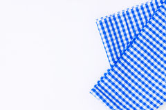 Blue cloth, a kitchen towel with a checkered pattern, on a white Stock Photos