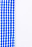 Blue cloth, a kitchen towel with a checkered pattern, on a white. Background isolated Royalty Free Stock Photos